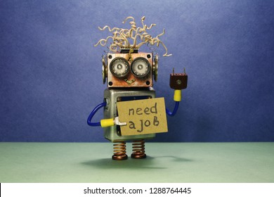 Robot looking for a job. The crazy unemployed toy robot holds cardboard announcement handwritten text Need a job. Blue green background