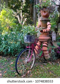 the robot is made up of tree pots and old bike