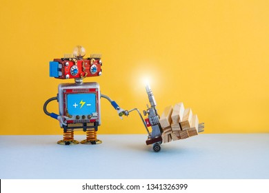 Robot moving powered pallet jack with wooden blocks. Forklift cart mechanism on blue floor, yellow wall background. Copy space. Robotic automation delivery service transportation logistic concept.