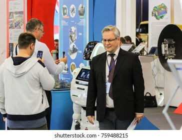 Robot and people. St. Petersburg, Russia - 3 October, 2017. People and robots at the St. Petersburg gas forum.