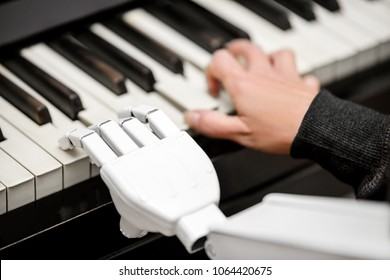 robot is playing a piano, closeup shot from a robotic arm using the keys
