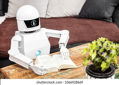 robot is reading some books and is showing his adaptive ai