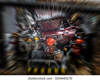 The robot repair factory has damaged. From the fight. Plastic model. Abstract image blur.