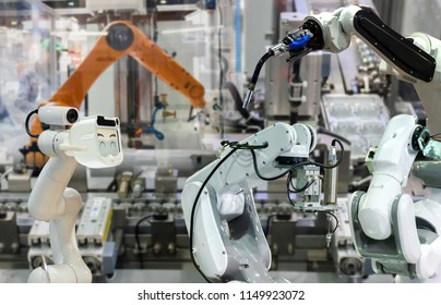 Robot replacement Industrial 4.0 of things technology robot future arm and man using controller for control electronic