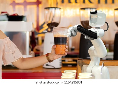 robot technology hold drinks to people work instead of man future  - Shutterstock ID 1164235831