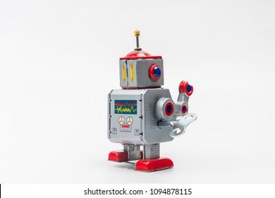 robot tin toy on white background .