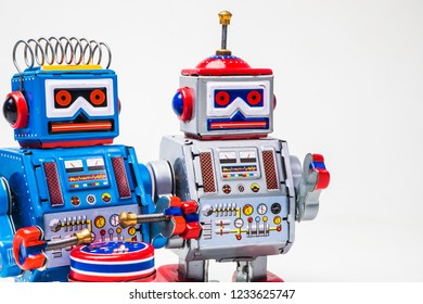 robot tin toy on white background . .