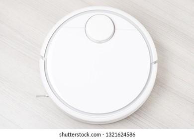 Robot vacuum cleaner, close-up on white light floor