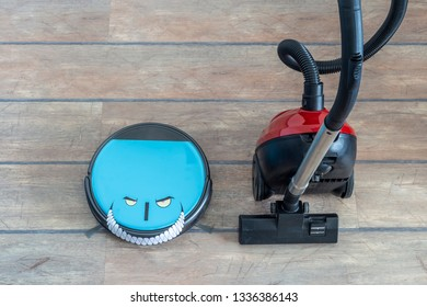 Robot vacuum cleaner with evil eyes and grin and regular vacuum cleaners side by side. Old versus new and technology evolution concepts.
