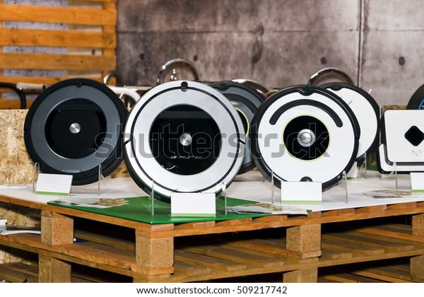 Robot vacuum cleaner on the shop stand, Smart robotic automate wireless cleaning technology machine