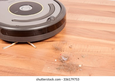Robot vacuum cleaner to pick up dirt prepared a wooden floor