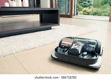Robot vacuum cleaner working in modern home