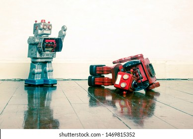 robot wars red robot defeated on old wooden floor