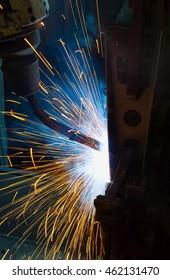 Robot welding automotive part.