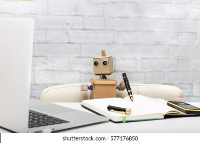 Robot working at a computer; workplace