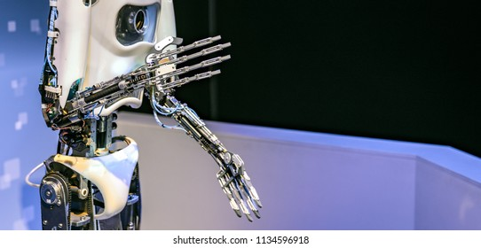 Robotic arm of a human like droid robot making a gesture.