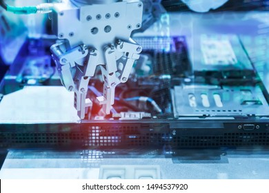 Robotic arm installing a computer chip with cpu