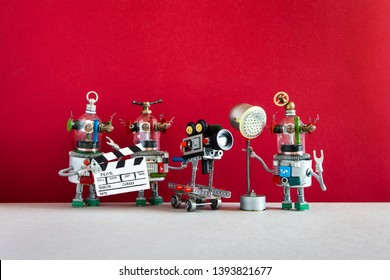 Robotic filmmaking. Crew robots shoots television movie or motion picture. Creative filmmakers robotic team director, assistant with spotlight and cameraman behind the scene