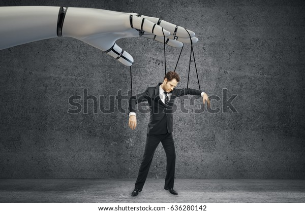 Robotic hand manipulating businessman on concrete background. Future concept