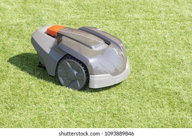 Robotic lawn mower on grass in side view