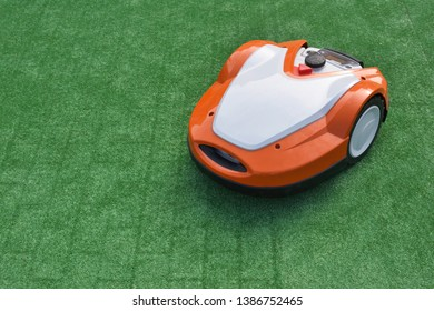 Robotic Lawn Mower on green background