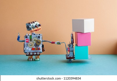 Robotic logistic delivery service concept. Robot moving big container with powered pallet jack. Forklift cart mechanism and boxes on brown wall, green floor background