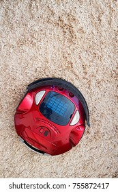 robotic vacuum cleaner on the floor and carpet red