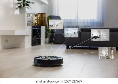 Robotic vacuum cleaner on laminate wood floor in living room