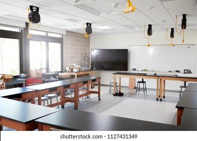 Robotic Vehicle On Desk In Empty Science Classroom