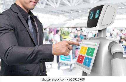 Robotics Trends technology business concept. Man suit point finger to Autonomous personal assistant robot for navigation direction in airport blur background. 3D rendering