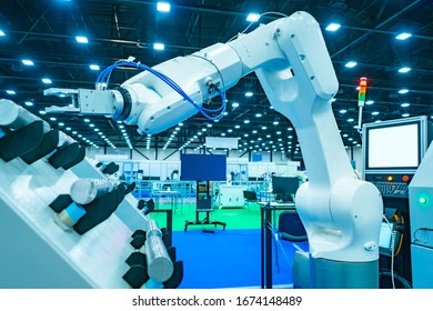 Robotics. White robot in the engineering laboratory. Programming of the robot manipulator. Creation of programs for industrial robots. The use of programmable machines in industry.