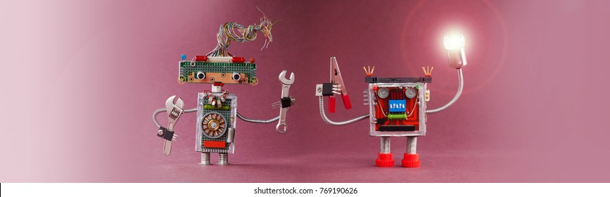 Robots 4th industrial revolution automation concept. Robotic handyman lights the way. Friendly mechanic toys with lamp, red pliers hand wrench. Pink violet background, copy space.