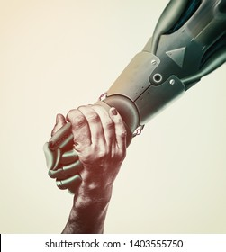 Robot's hand pulls a woman hand. Two hands on rescue position. Artificial intelligence, concept of future.