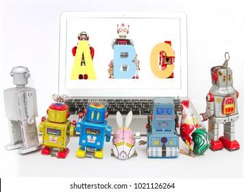 robots teching robots ABC  on a laptop