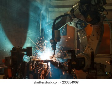 robots welding in a car factory