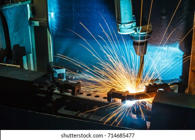 Robots Welding machine in a car factory, manufacturing, industry