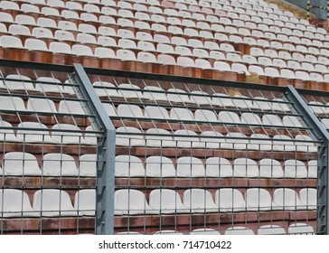 Robust metal mesh in the stadium to divide the fans on the stairs from the players during the sports meetings