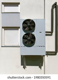 Robust old  industrial air conditioner mounted on wall.