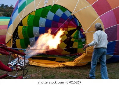 ROCAMADOUR, FRANCE- SEPTEMBER 24: Hot air balloon inflating at dawn for the 26ème Montgolfiades de Rocamadour, on September 24, 2011 in Rocamadour, France.