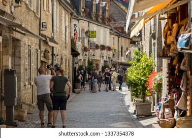 Rocamadour, France - September 3, 2018: Tourists walking in the medieval centre of Rocamadour. France