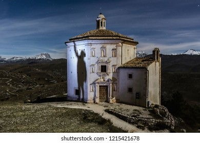Rocca Calascio Fortress with moon Light Time, with Shadow - A Medieval Castle Built over the Peak of Mountain in Abruzzo - Italy, Corno Grande background