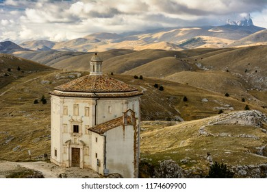 Rocca Calascio Fortress at the Sunset Time - A Medieval Church Built over the Peak of Mountain in Abruzzo - Italy