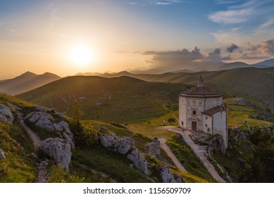 Rocca Calascio (Italy) - The ruins of an old medieval village with castle and church, over 1400 meters above sea level on the Apennine mountains in the heart of Abruzzo, at sunset.