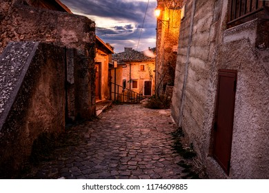 Rocca Calascio Town at the Evening Time - A Medieval Castle Built over the Peak of Mountain in Abruzzo - Italy