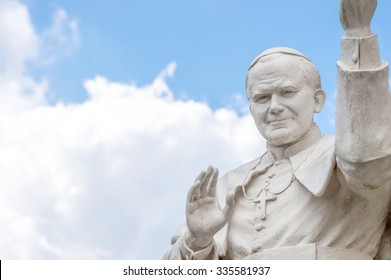 Rocca di papa, Italy - June 2015 - A statue of pope St John Paul II blessing people, with cloudy sky in the background, with copy space for text