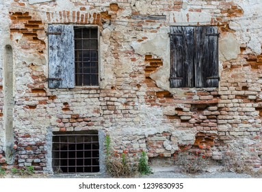 Rocchetta Tanaro, Piedmont, Italy - July 2, 2018: Wall of an abandoned building with door and windows.