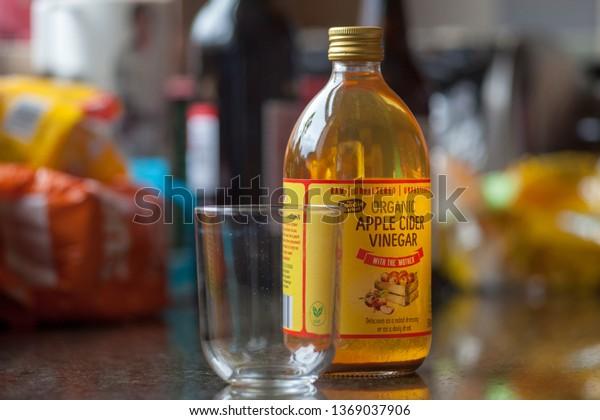 Rochdale, United Kingdon, April 2019: Apple Cider Vinegar sitting on kitchen worktop