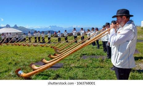 ROCHERS DE NAYE, SWITZERLAND - August 14, 2016: A group of Swiss musicians were playing Alpine horn, a traditional instrument, at the peak of Rochers de Naye, Switzerland.