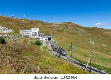 Rochers-de-Nye, Switzerland - September 9 2018: A train is leaving the Rochers-de-Nye train station heading towards Montreux, Switzerland