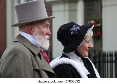 ROCHESTER CITY, KENT, ENGLAND - DEC 11: Couple play Dickens characters at annual Rochester Dickens Festival on December 11, 2010. in Rochester, England